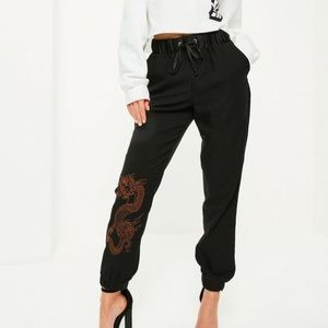 Black snake embroidered crepe cuffed jogger pants
